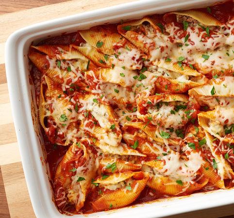 Ricotta, mozzarella, parmesan cheese, fresh basil, and marinara sauce